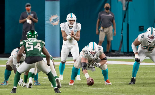 Miami Dolphins quarterback Tua Tagovailoa (1) takes his first snap against the New York Jets at Hard Rock Stadium in Miami Gardens, October 18, 2020. (ALLEN EYESTONE / THE PALM BEACH POST)