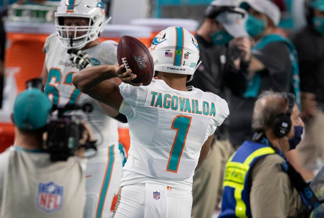 Dolphins quarterback Tua Tagovailoa warms up to debut vs. the Jets.