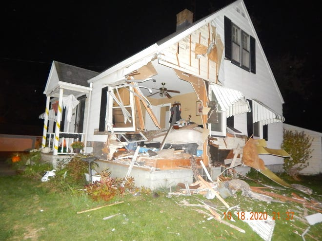 Troopers say the vehicle a Mineral City woman was driving at a high rate of speed went airborne, and struck this house. (Ohio Highway Patrol)