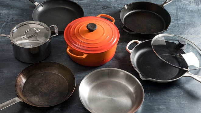 COOKING BASICS - Investing in a few decent pieces of cookware will make cooking easier and your food better. America's Test Kitchen expert says every kitchen should have a Dutch oven, two large skillets and a large saucepan. (Photo courtesy of Kevin White/ATK)