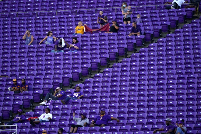 Limited fans watch a game between East Carolina and Central Florida at Dowdy-Ficklen Stadium on Sept. 26. ECU athletic director Jon Gilbert announced the latest steps the athletic department must take due to the financial restraints from COVID-19, which includes limited attendance at home football games. (AP Photo/Gerry Broome)