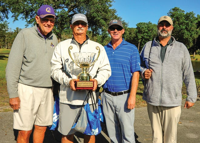 With a score of 60, the team of Louis Godwin, Billy Holton, Barry Mills and Mitch Kominiarek won the men's division at the 20th Annual Pamlico Community College Foundation CarolinaEast Cup Golf Tournament. [CONTRIBUTED PHOTO]