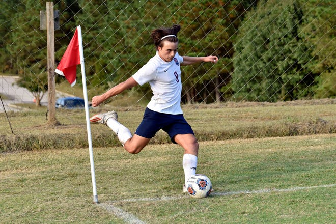 Rey Molina fires a corner kick during Freedom Christian's game against Fayetteville Christian for the NCISAA Sandhills Conference tournament championship. Molina was named the conference player of the year.