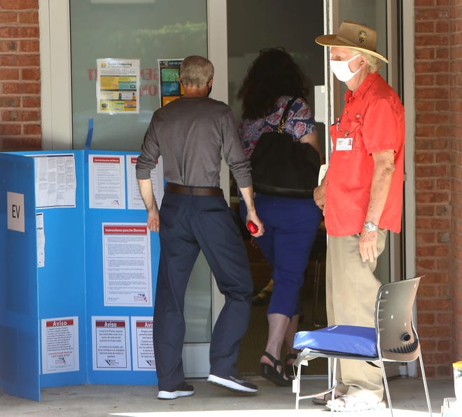Residents walk into the early voting location at the Millhopper Branch Library to vote on Monday. Alachua County has six early voting locations that are open daily 9 a.m. to 6 p.m. through Oct. 31.