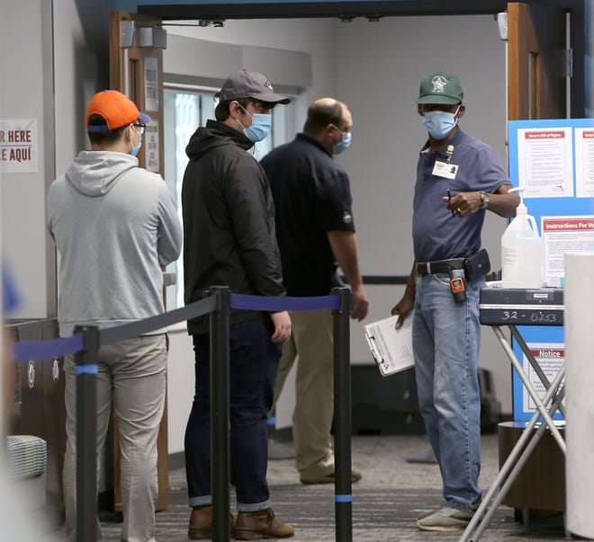 Voters line up at the early voting location at the Reitz Union on the University of Florida campus on Oct. 19. Alachua County has six early voting locations that are open daily 9 a.m. to 6 p.m. through Oct. 31.