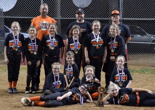 The Strasburg Tigers 10 and under girls softball team won the 2020 Fall Tournament held at Dover Park. The team ended up at 12-0-1.  The team members are: FRONT Hallie Argabrite and Madalyn Whalen. SECOND ROW  Andelyn Jones, Josie Lunau, Bella Lindsay and Karson Kramer. THIRD ROW Lily Lyons, Adrena McComb, Kameron Dreher, Peyton Martin, Ashlynn Crouse and  Autumn Portmann. BACK Todd Whalen, Bill Martin and Dan Argabrite. Don Krantz was absent.