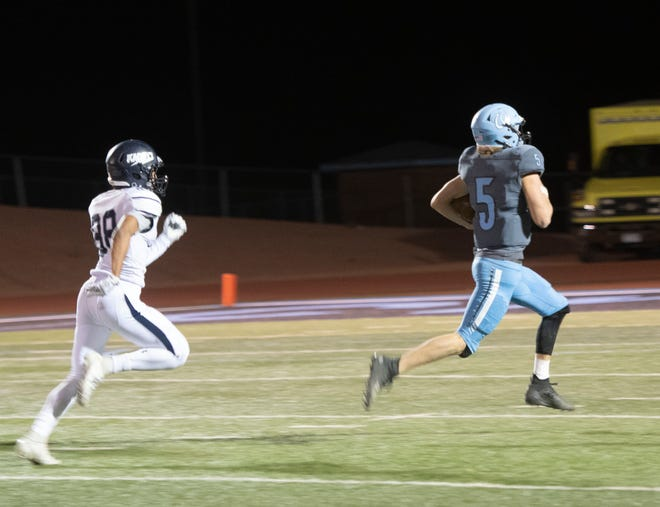 Pueblo West quarterback out runs an Air Academy defender to score on a 61-yard touchdown run during the Cyclones 33-0 win last Friday at home. Brinkley threw for two touchdowns and ran for two in the victory.