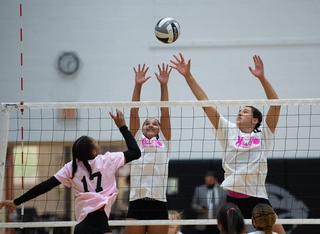 """North's Brooke Norwood (center) and Lilian Muszynski go for a block against Central's Myriah Massey on Sept. 29. Norwood finished the regular season with 1,251 career assists while displaying a variety of skills. """"She probably is the best defensive setter I've seen in a very long time,"""" coach April Boudreau said."""