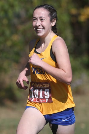 Gahanna Lincoln's Alyssa Shope had good reason to be smiling Oct. 17 during the OCC-Ohio meet at Pickerington Central. The junior won the race in 18 minutes, 55 seconds as the girls team placed second behind Pickerington North.