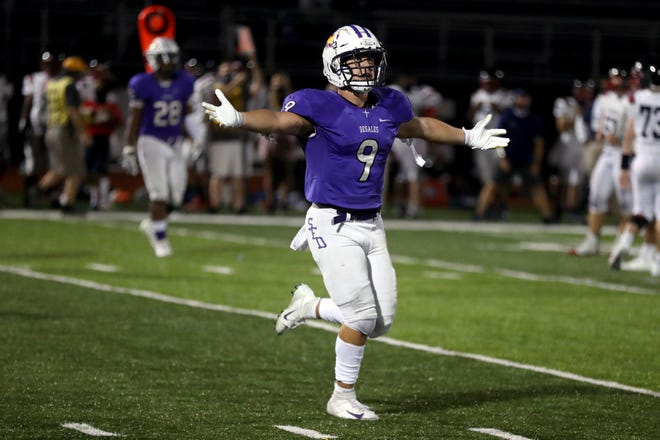 """Jason Velazquez II celebrates in the waning moments of DeSales' 24-21 win over Hartley on Sept. 11. Velazquez has tried to set a good example this season by following COVID-19 protocols. """"As a senior and leader on this team and knowing this season almost didn't happen, you've got a whole new appreciation for it,"""" he said."""