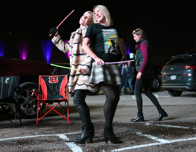 Sisters Kasey Johansen (left) and Kelli Wilson of Upper Arlington dance in the front row of vehicles as Fitz and the Tantrums performs during a drive-in concert held Oct. 16 by Prime Social Group at Westland Mall in Columbus. The socially distanced concert was part of a series that includes Dirty Heads from 5 to 9 p.m. Sunday, Oct. 25, Bone Thugs-N-Harmony with Twista from 6 to 10 p.m. Friday, Oct. 30, and NGHTMRE On Broad Street featuring NGHTMRE & Ghastly from 6 to 11 p.m. Saturday, Oct. 31. Tickets are available at westlanddrivein.com.
