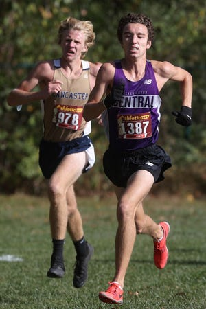 Central's Chase Balko and Lancaster's Noah Johnson compete in the OCC-Buckeye Division meet Oct. 17 at Central. Balko placed fourth and Johnson finished sixth as the Tigers wound up in second place behind the Golden Gales.