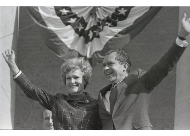 President Richard M. Nixon traveled across the country campaigning for Republican candidates during the 1970 midterm election. Nixon, whose father had lived in Columbus and was a streetcar driver, is shown with his wife, Pat, at a rally Oct. 19 for Robert Cloud, a candidate for governor, and Robert Taft Jr., a candidate for U.S. Senate. The rally attracted a crowd estimated at 40,000. After his speech, Nixon made a surprise visit to the Ohio State University campus.