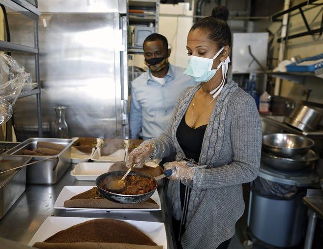 Tigi Zemene (front) and Birhan Ayele make mushroom combos to serve at the new Nile Vegan restaurant in Grandview Heights.