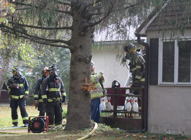 Wellsville firefighters respond to a fire at 2884 Florida Ave. Sunday morning.