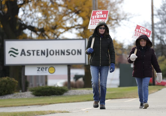 AstenJohnson lab technician Sheila Beschta, left, and seamer Mary Jane Beschta walk the picket line Monday in Greenville. They were among the union employees who voted down the latest contract on Wednesday.