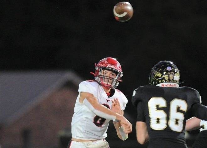 Eastland quarterback Behren Morton, left, delivers a pass during Eastland's 31-17 victory against Comanche in October. Texas Tech hopes to sign Morton, a consensus state top-50 prospect, at the start of the national signing period on Wednesday. But that's uncertain after Tech fired offensive coordinator David Yost on Monday.