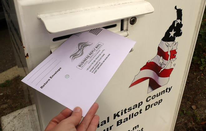 A ballot is dropped into the box at the Norm Dicks Government Center in Bremerton on Monday, October 19, 2020.
