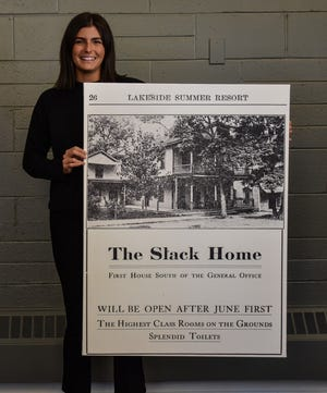 Elizabeth Fantozzi, Lakeside Chautauqua's Marketing and Public Relations Manager, holds a print of an early advertisement for The Slack Home, which offered room and board inside the Slack House.