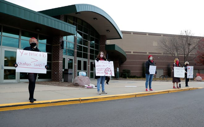Students outside West De Pere High School protest the school board's decision to resume in-person learning on Oct. 19, 2020.