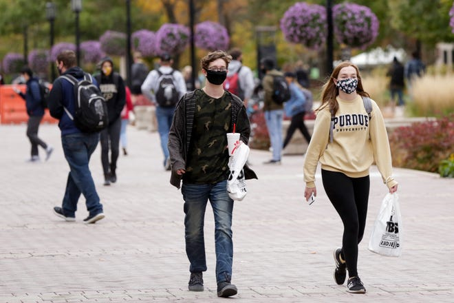 Students walk through Purdue University's campus, Monday, Oct. 19, 2020 in West Lafayette.
