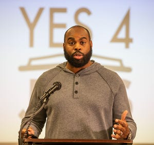 Former University of Louisville and NFL star Michael Bush speaks at a press conference Monday in Louisville.