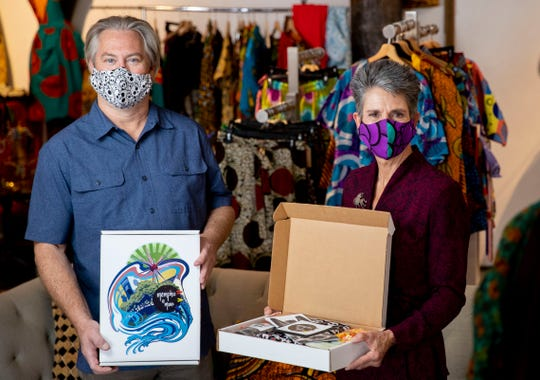 Mark McLeod and Pam Routh hold a pair of their Memphis is More boxes Monday, Oct. 19, 2020, at Mbabzi House of Style in Memphis.