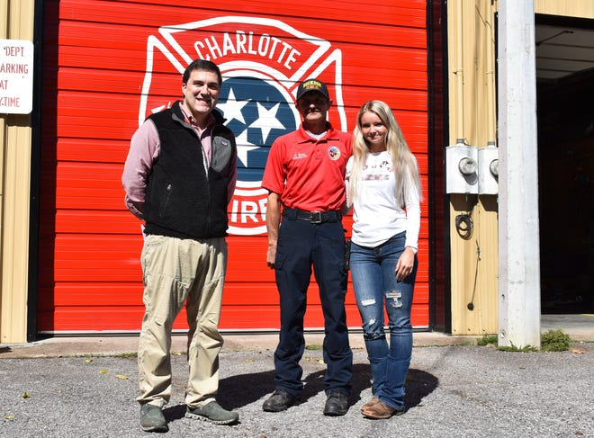 Pictured are, from left, Dr. John Stritikus, Charlotte firefighter Shannon Yates, and Hailey Dotson.
