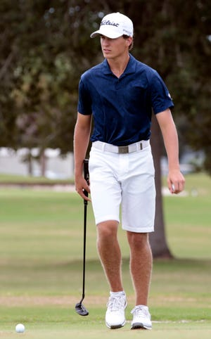 Sam Kodak of Naples High competes in the Class 2A-Region 3 boys golf tournament Monday, Oct. 19, 2020 at Port Charlotte Golf Club in Port Charlotte.  Kodak shot a 2-under 70 to earn medalist honors.