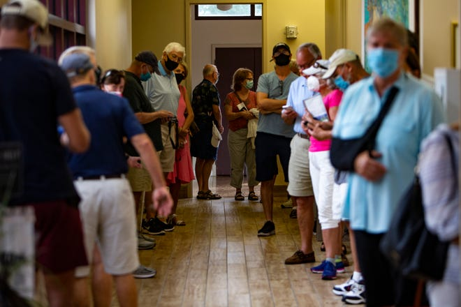 Naples residents fall in line to cast their votes during the first day of early voting, Monday, Oct. 19, 2020, at the Norris Center in Naples.