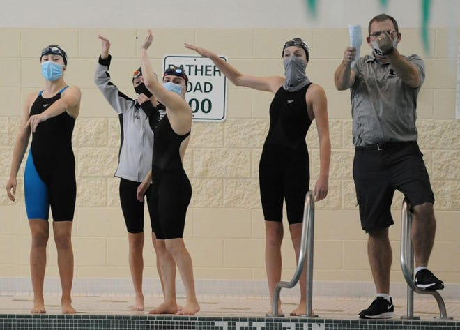 The South Lyon East girls swim and dive team has adapted during the 2020 season.