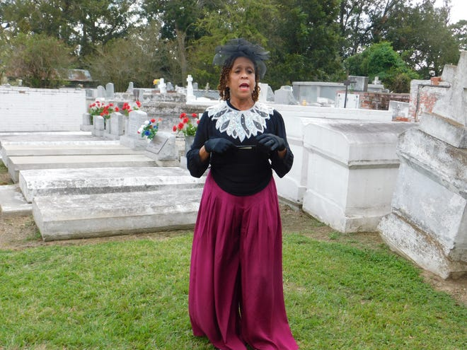 Sheryl Ned portrays Madame Baldwin, an Opelousas business owner and free woman of color from the city's history, during the 18th annual St. Landry Church Cemetery tour, which concluded Sunday. During the event, groups are guided among the gravesites in the St. Landry Catholic Church cemetery  where they were met by reenactors portraying former prominent residents who helped to shape St. Landry Parish history.