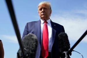 President Donald Trump talks to reporters at Phoenix Sky Harbor International Airport, Monday, Oct. 19, 2020, in Phoenix.