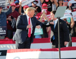 President President Donald J. Trump elbow bumps Ariz. Gov. Doug Ducey during a Make America Great Again Rally in Tucson, Ariz. Oct. 19, 2020.