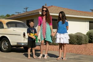 Laura Parsons, center, poses for a photo with her two children Henry, left, and Lily on Oct. 18, 2020, in Phoenix.