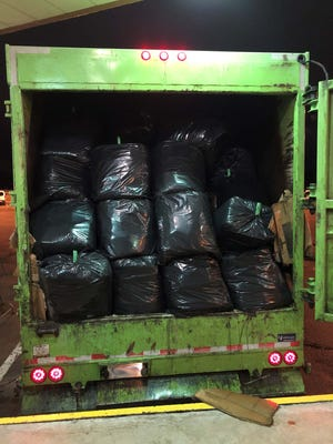 More than 1,000 pounds of marijuana were found concealed in trash bags at the back of a refuse hauler late on Sunday, Oct. 18, 2020, at the Blue Water Bridge.