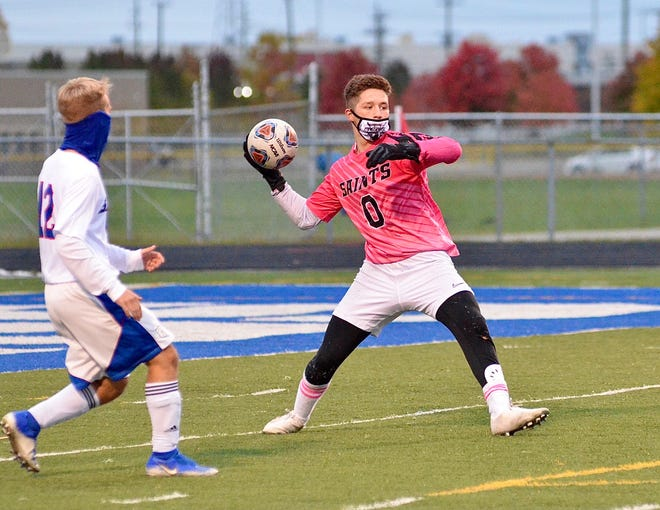 St. Clair's Kalvin Heid tosses the ball in play against Marysville during a Division 2 boys soccer district semifinal match on Monday, Oct. 19, 2020, at Walt Braun Stadium.