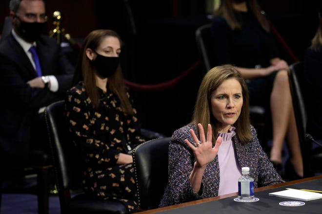 U.S. Supreme Court nominee Judge Amy Coney Barrett testifies during the third day of her confirmation hearing before the Senate Judiciary Committee on Capitol Hill Wednesday, Oct. 14, 2020 in Washington, D.C. (Yuri Gripas/Abaca Press/TNS)