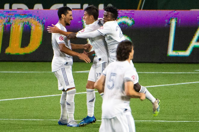 Los Angeles FC forward Christian Torres (21) celebrates with teammates after scoring a goal in the second half against the Portland Timbers at Providence Park. The game ended tied 1-1.