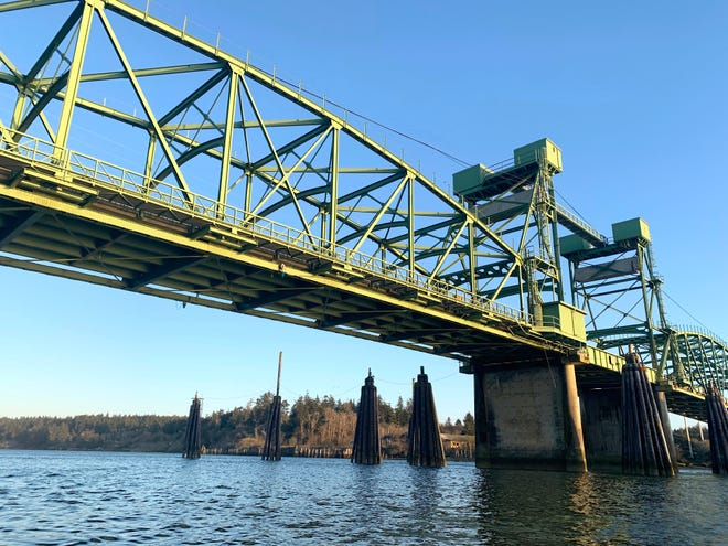 View of the Green Bridge of Highway 101 over the Coquille River from the seat of a kayak.