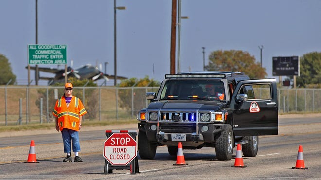 A roadblock is set up near the south gate of Goodfellow Air Force Base diverting traffic away from the scene of a suspected bomb threat Monday, Oct. 19, 2020.