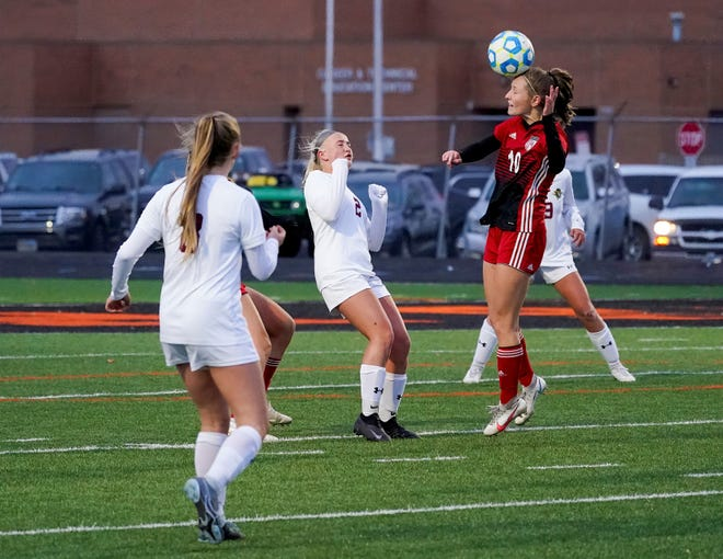 Brandon Valley senior Julia Kreutner goes for the header during Saturday's championship win.