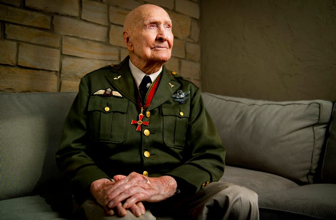 "Gail Halvorsen, also know as the ""Candy Bomber"", poses for a portrait at his son's home in Midway, Utah, on Wednesday, Oct. 7, 2020. Air Force Colonel (retired) Gail S. Halvorsen changed the course of history with just two pieces of gum. Now has made a bit of his own history. Halvorsen turned 100 years old this month. (Isaac Hale/The Daily Herald via AP)"