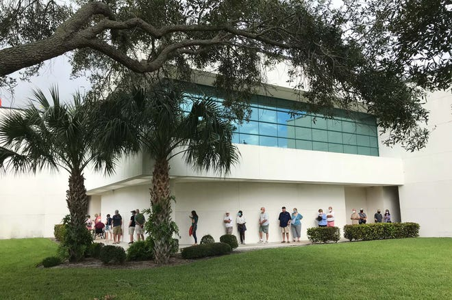 Voters may find long lines at their precincts on Election Day. On the first day of early voting in Indian River County, the line wrapped around the Main Library when the poll opened at 7 a.m. Oct. 19, 2020, in Vero Beach.