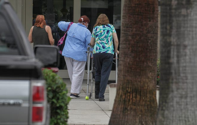 A steady flow of voters are seen at the Hoke Library, casting their ballots on the first day of early voting, on Monday, Oct. 19, 2020, in Jensen Beach.