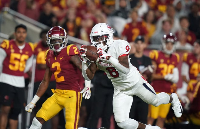 Aug 31, 2019; Los Angeles, CA, USA; Fresno State Bulldogs wide receiver Chris Coleman (8) catches a pass as Southern California Trojans cornerback Olaliah Griffin (2) defends in the fourth quarter at Los Angeles Memorial Coliseum. USC defeated Fresno State 31-23. Mandatory Credit: Kirby Lee-USA TODAY Sports