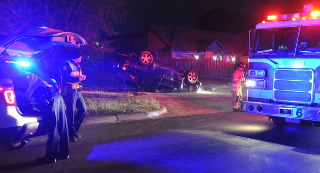 Wichita Falls police work the scene of a rollover accident Sunday night near Call Field Road.