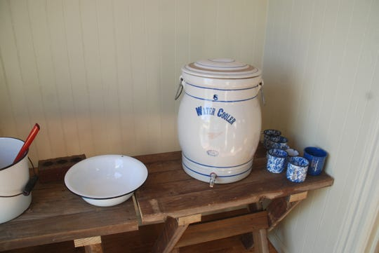 The schoolhouse grounds still include a privy out back and this crockery drinking water station right inside one of the two front doors of the schoolhouse.