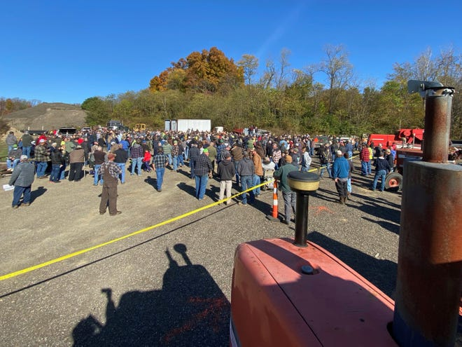 Hundreds gather outside the Muskingum County Sheriff's Office to bid on farm equipment seized from drug dealer Dwight Taylor's properties.