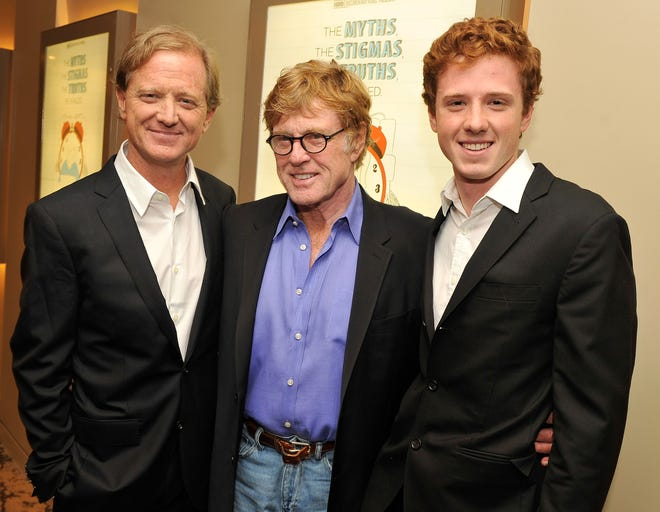 """Film legend Robert Redford, center, poses with his son, filmmaker James Redford, left, and his grandson, Dylan Redford, at the 2012 premiere of """"The Big Picture: Rethinking Dyslexia."""" Dylan was the subject of the film, which was directed by his father. James Redford died Friday at the age of 58."""
